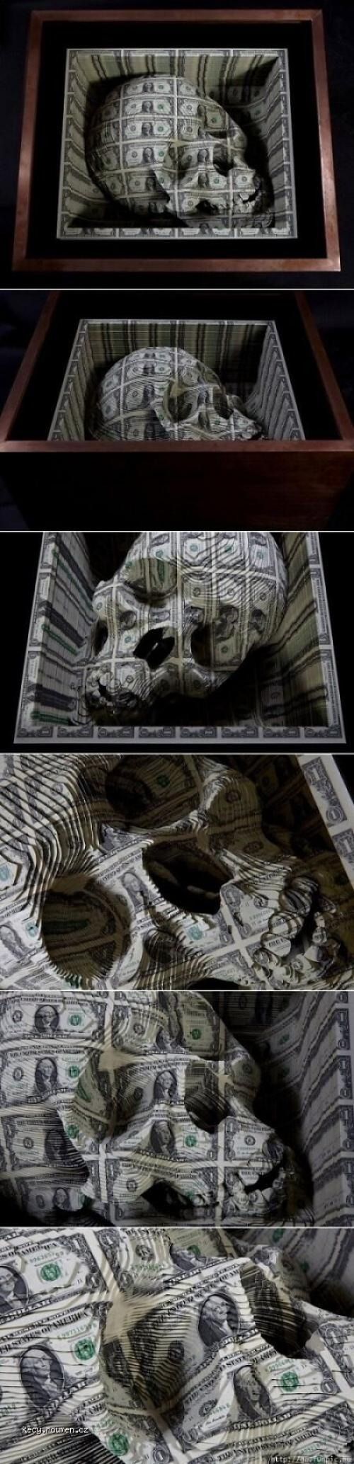 A skull carved from 1 dollar K in cash