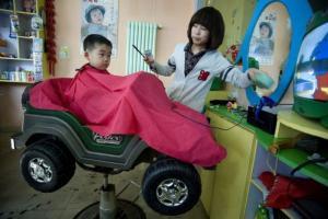 Kluk u holiče