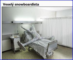 Veselý snowboardista