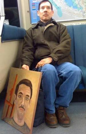 Man Poses for Picture of Himself with a Picture of Himself