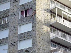 Naked Man Scales Wall