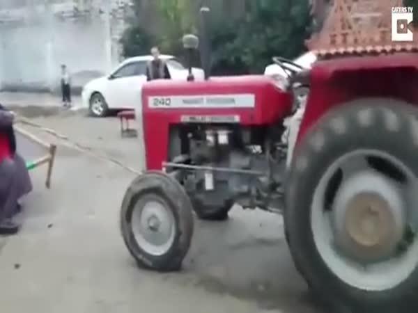 408 kg silný muž vs. traktor